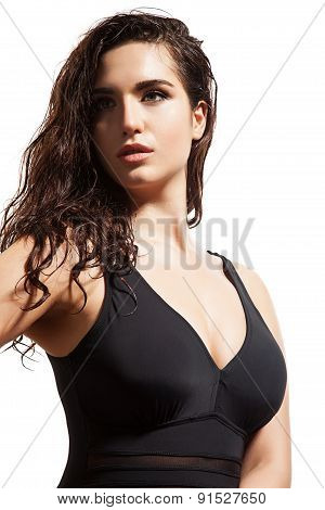 Beautiful woman in a swimsuit on white background