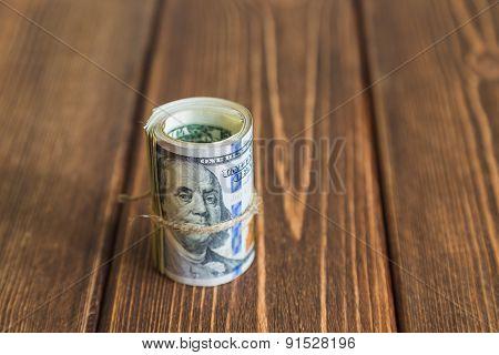 Stacks of dollars banknotes on wooden desk