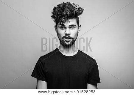 Young handsome man doubting isolated over gray