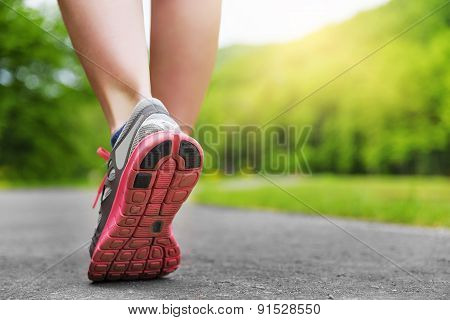Woman's Legs In Shoes.