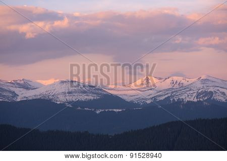 Morning landscape. Spring in the mountains. Snow on the tops