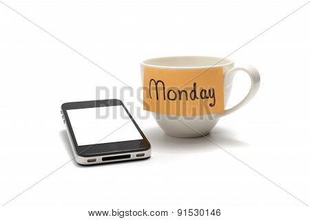 Mondat Note With Coffee Cup And Cellphone