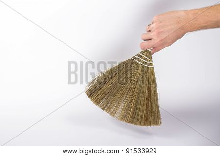 broom in a man's hand isolated