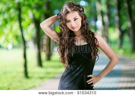 Beauty Woman in Black Dress Outdoor in Green Park