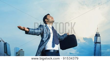 Successful Businessman With Arms Outstretched Celebrating Success. Man With Arms Wide Open. Outdoors