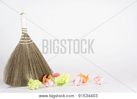 besom and color waste paper isolated