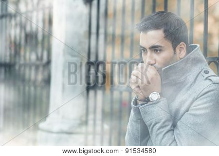 Young Man Blowing Into Their Hands Or Heats Hands, Coldly Morning With Fog