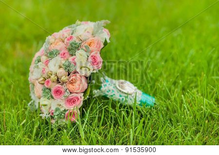 bridal bouquet on grass background