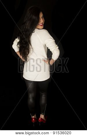 Back View Of A Woman Standing In Black Leather Pants
