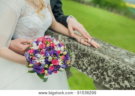 Groom and the bride with wedding bouquet
