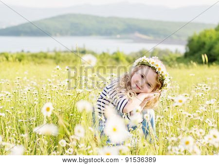 Cute Little Girl In The Chamomile Field