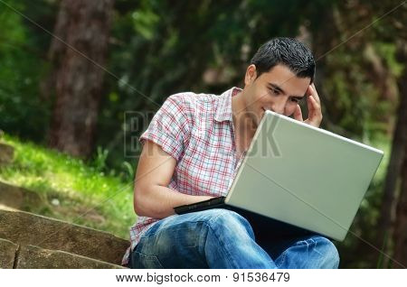 Young Men With Lap-top