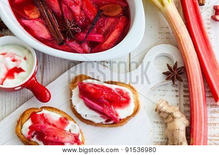Toasted bread with yogurt and top with syrupy spiced rhubarb
