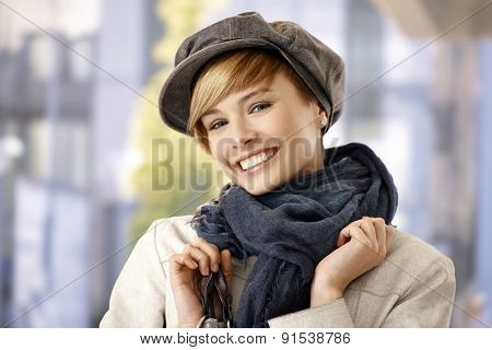 Attractive young woman in winter clothes, smiling.