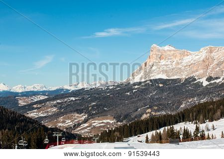 Mountain Peak With Shadow, Sun, Sky And Ski Lift