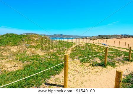 Wooden Fence By The Shore In Porto Pollo