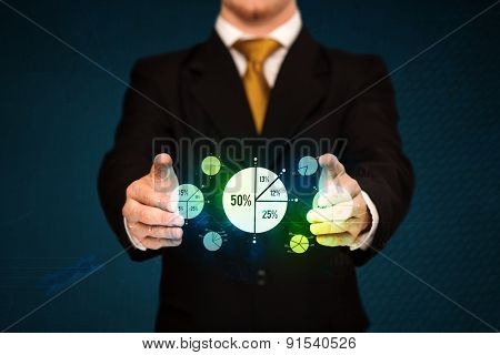 Businessman holding business diagrams, concept of success