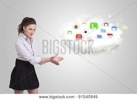 Young woman presenting cloud with colorful app icons and symbols concept