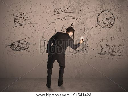 Businessman drawing a business project on a wall