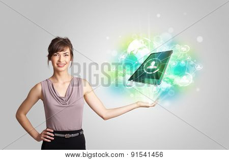 Business girl showing modern green tablet technology concept