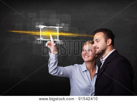 Tech couple touching button with orange light beams concept