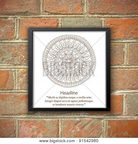 Monochrom mandala in black frame on the brick wall.
