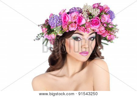 Studio Portrait Of A Beautiful Woman With Flowers Rose In Her Hair. Isolated.