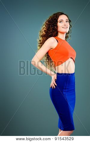 Portrait of a beautiful young woman with long curly hair. Beauty, fashion.