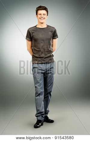 Full length portrait of a cheerful young man. Men's beauty, fashion. Studio shot.