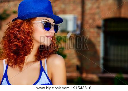 Attractive young woman beautiful foxy hair outdoors. Beauty, fashion.