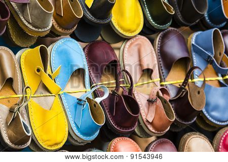 Leather Shoes In Different Colors At A Flea Market