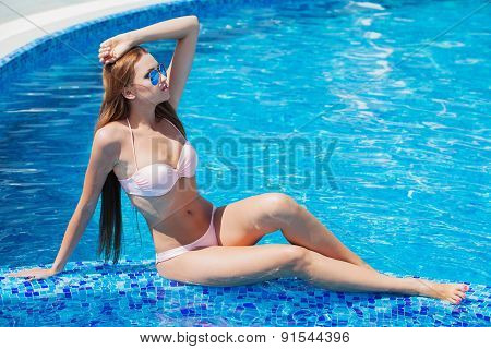 young beautiful woman at a pool