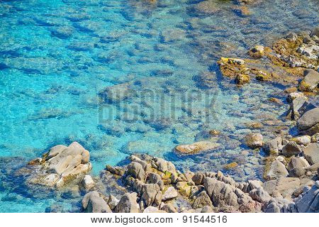 Rocks In Capo Testa Clear Water