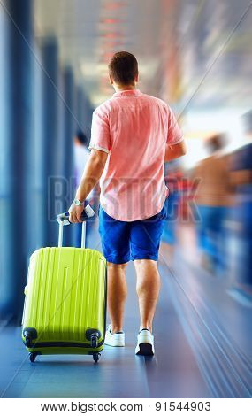 Young Man Runs, Hurry In Order Not To Miss The Plane