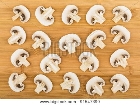 Background From Slices Of Raw Champignons On Board