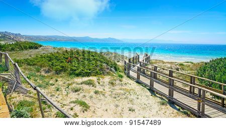 Boardwalk In Capo Testa Under A Cloudy Sky