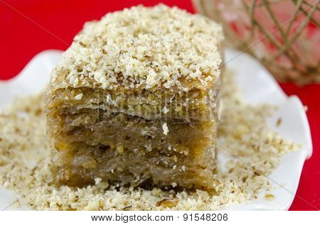 Baklava With Grated Walnuts On A Plate