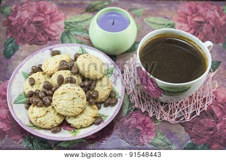 Integral Cookies And Chocolate Balls On A Colorful Table