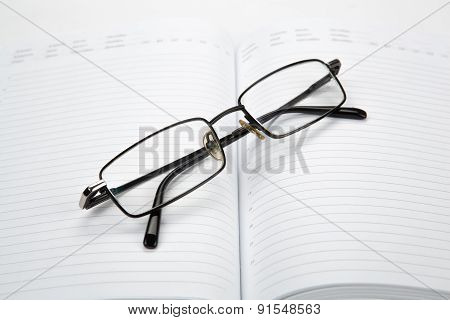 Business Diary With Eyeglasses