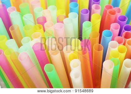 Colorful drinking straws close-up background, colorful plastic tubes
