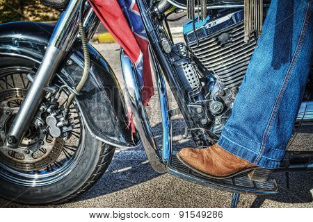 Woman Boot On A Classic Motorcycle Floorboard