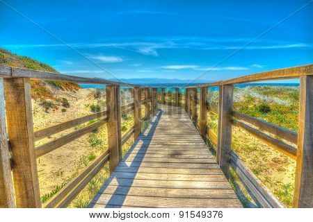 Wooden Boardwalk To The Beach
