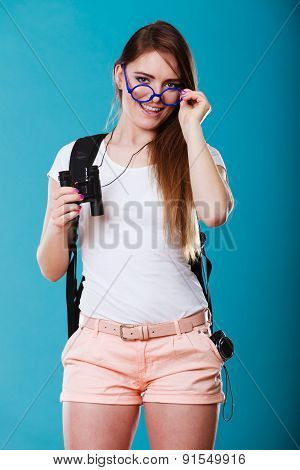 Tourist Woman With Binoculars On Blue