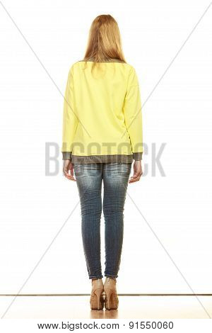 Woman In Denim Pants Yellow Blouse Back View