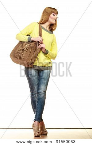 Woman Holds Brown Fringe Handbag