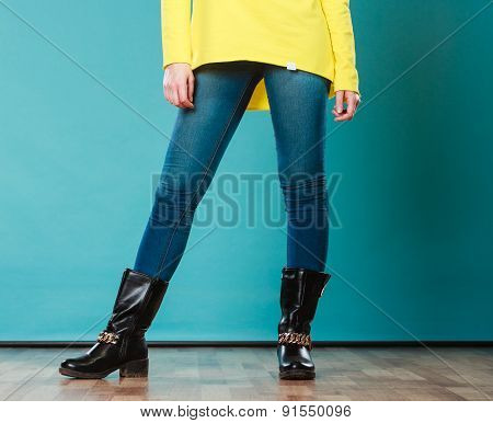 Woman Legs In Denim Trousers Boots