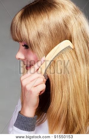 Closeup Girl Combing Her Long Hair