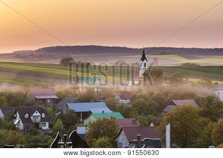 Sundown Over Village In Poland