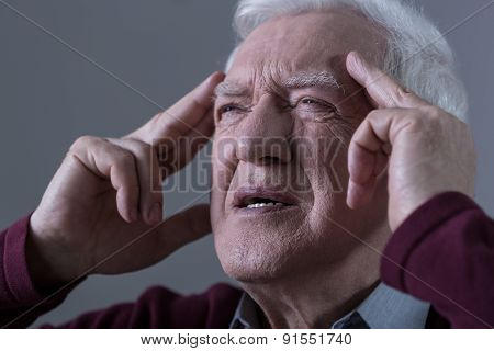 Man Holding His Temples