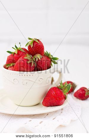 Strawberries In Ceramic Cup On A White Background